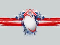Bola de rugby em um fundo do grunge com bandeira Foto de Stock Royalty Free