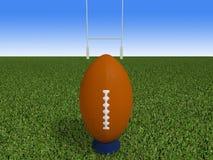 Bola de rugby em uma grama Fotos de Stock Royalty Free