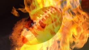Bola de rugby no fogo video estoque