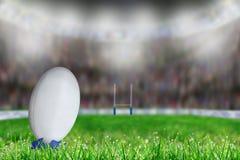 Bola de rugby no T no estádio com espaço da cópia Foto de Stock Royalty Free