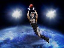 Bola de travamento do jogador de futebol americano Foto de Stock Royalty Free