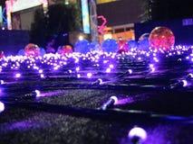 Bola de vidro com decorações claras Fotografia de Stock