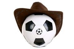 Bola del balompié con el sombrero de vaquero imagen de archivo