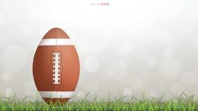 Bola del fútbol americano o bola del rugby en hierba verde ilustración del vector