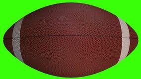 Bola del f?tbol americano - primer del objeto del deporte 3D, v?deo animado en la pantalla verde almacen de metraje de vídeo