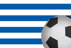 Bola del fútbol contra la bandera de Uruguay Foto de archivo libre de regalías