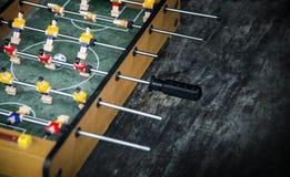 Bola del foco en juego de tabla del fútbol del comienzo Concep del juego del deporte del juguete del muchacho Imagen de archivo