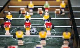 Bola del foco en juego de tabla del fútbol del comienzo Concep del juego del deporte del juguete del muchacho Fotos de archivo libres de regalías