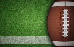 Bola del fútbol americano en hierba Fotografía de archivo libre de regalías