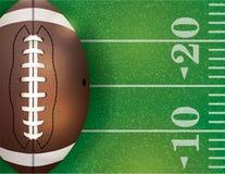 Bola del fútbol americano y ejemplo del campo Foto de archivo libre de regalías