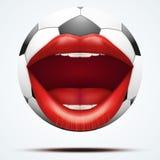 Bola del fútbol con una boca femenina que habla Foto de archivo libre de regalías