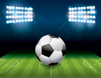 Bola del fútbol del fútbol en el ejemplo del campo Fotos de archivo