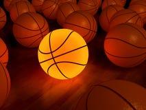 Bola del resplandor del baloncesto Fotos de archivo libres de regalías