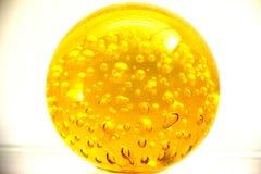 Bola do óleo do ouro amarelo fotos de stock