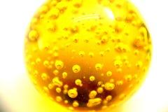 Bola do óleo do ouro amarelo Imagens de Stock Royalty Free
