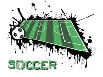Bola e campo de futebol em um fundo das manchas da pintura Imagem de Stock