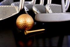 Bola e hierros de oro Foto de archivo libre de regalías