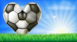 Bola en forma de corazón del fútbol Fotografía de archivo libre de regalías