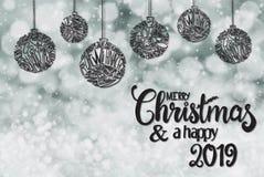 Bola, Feliz Navidad y un 2019 feliz, Gray Background oscuro de la caligrafía foto de archivo libre de regalías