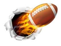 Bola llameante del fútbol americano que rasga un agujero en el fondo Imágenes de archivo libres de regalías