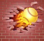 Bola llameante del softball que se rompe a través de la pared de ladrillo Imágenes de archivo libres de regalías
