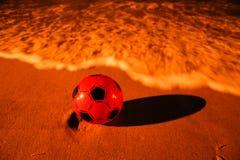 Bola na praia Imagem de Stock
