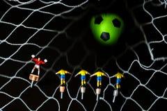 A bola no objetivo com os jogadores brinca Foto de Stock Royalty Free