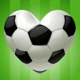 Bola para el balompié en la dimensión de una variable del corazón Fotografía de archivo libre de regalías
