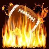 Bola para el fútbol americano en el fuego Imagen de archivo libre de regalías