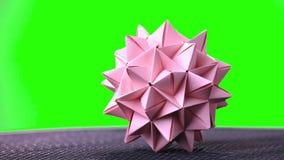 Bola pontudo do origâmi cor-de-rosa video estoque