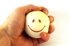 Bola sonriente a disposición Fotos de archivo libres de regalías