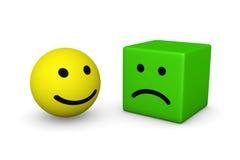 Bola sonriente feliz y cubo sonriente triste Imagen de archivo