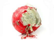 Bola vieja roja aislada Imagen de archivo