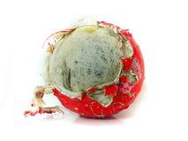 Bola vieja roja aislada Fotos de archivo