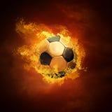 Bola y fuego de fútbol Fotos de archivo libres de regalías