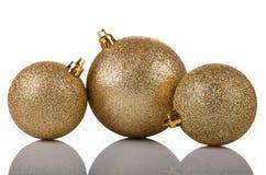 Bolas brillantes de oro Imagenes de archivo