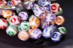 Bolas coloridas da loteria em uma esfera Fotos de Stock