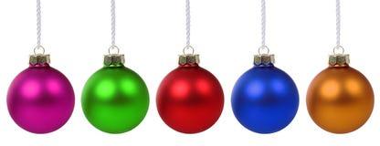 Bolas coloridas de la Navidad en fila aisladas Fotos de archivo