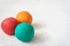Bolas coloridas del playdough Imagenes de archivo