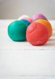 Bolas coloridas del playdough Imagen de archivo