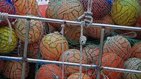 Bolas coloridas en redes Imagen de archivo libre de regalías