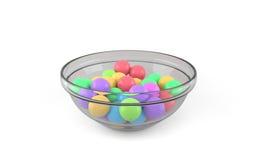 Bolas coloridas na bacia de vidro 3d Foto de Stock