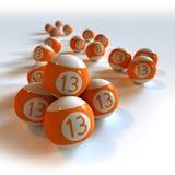 Bolas de billar anaranjadas con el número 13 Imagen de archivo
