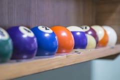 Bolas de billar en el estante Imagen de archivo libre de regalías