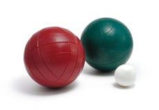 Bolas de Bocce verdes rojas y Pallino (Boccino) Foto de archivo libre de regalías