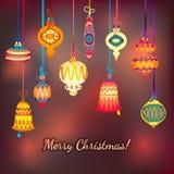 Bolas de cristal de la Feliz Navidad en fondo púrpura rosado Imágenes de archivo libres de regalías