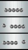 Bolas de equilibrio de la horquilla de Newton, tres posiciones Imagenes de archivo