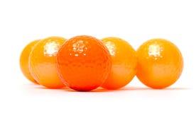 Bolas de golfe alaranjadas e douradas Imagens de Stock