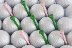 Bolas de golfe e T Fotografia de Stock