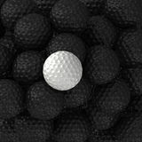 Bolas de golfe preto e branco Foto de Stock